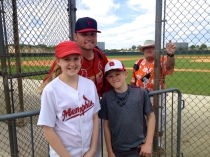 James Ramsey poses with the kids on the back fields